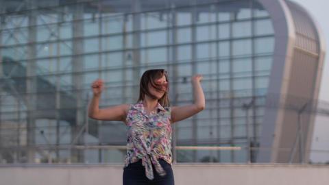 Happy woman tourist dancing, having fun, enjoying dance and celebrating success Live Action