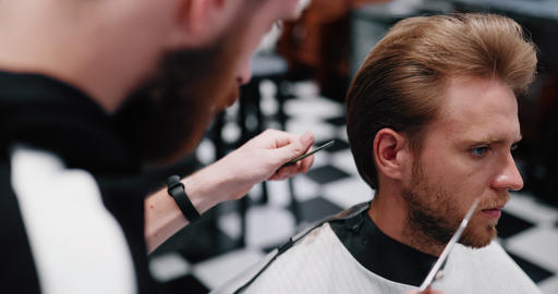 Stylish men's haircut. Barber does hair styling work Live Action