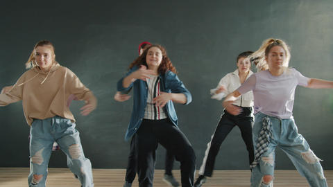 Slow motion of dancers team performing indoors together enjoying music Acción en vivo