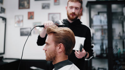 Drying and styling of men's hair. Slow motion Live Action