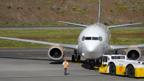 Airliner Pulled by a Tractor. Boeing B737 at Madeira Airport Ultra HD 4K Live Action