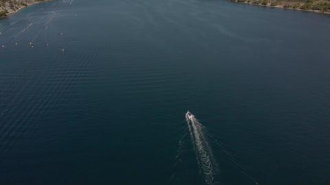Motor boat moves along long sea bay of Adriatic Sea. Aerial of Croatia Live Action
