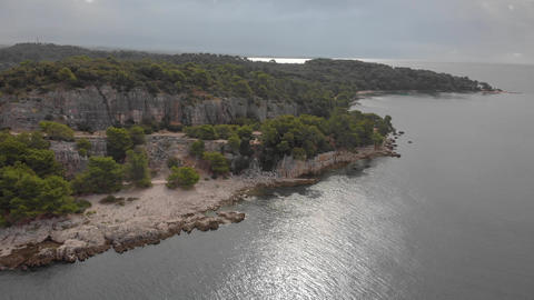Former quarry in rocks at the sea shore. Park forest Zlatni Rt at Rovinj GIF