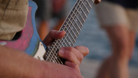 Musician fingers move across fingerboard of electric guitar. Chords for music GIF