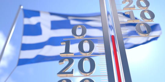 Thermometer shows 0 zero air temperature near waving flag of Greece. Weather Photo