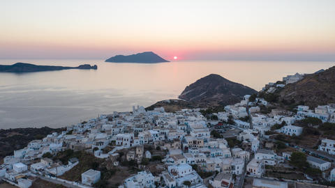 Aerial Hyper Lapse Moving Time Lapse above Typicall Greek Village at Sunset on Live Action