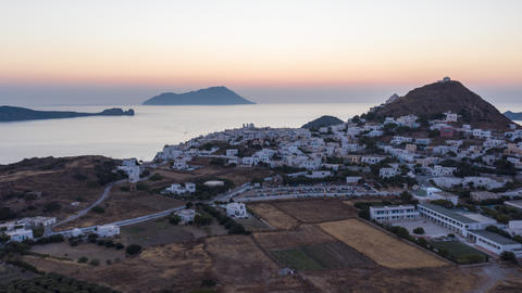 Aerial Hyper Lapse above typicall Greek Village at Sunset overlooking the Aegean Live Action