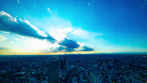 A timelapse of panoramic cityscape in Tokyo high angle wide shot tilt GIF