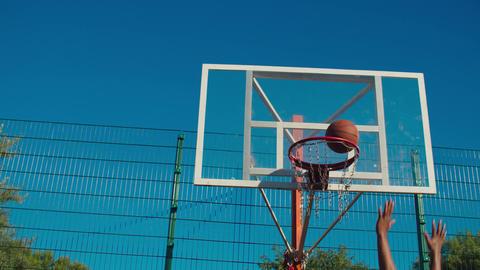 Action shot of ball going through basketball hoop GIF