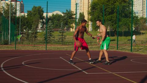 Streetball payer scoring field goal at urban court GIF