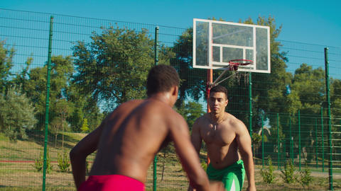 Shirtless fit sportsmen playing streetball outdoor GIF