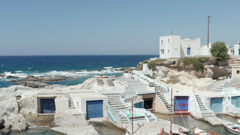 Aerial trough Scenic Little Greek Fishing Village with typical white Houses Live Action