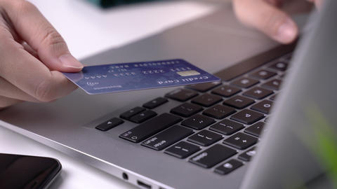 Office online paying, stay home shopping, electronic payment with credit card concept, laptop on Live Action