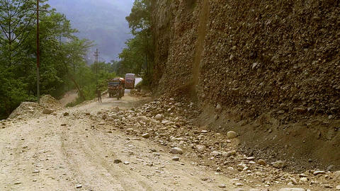 Landslides and rockfalls on the road in the mountains. Rocks blocking the road Live Action