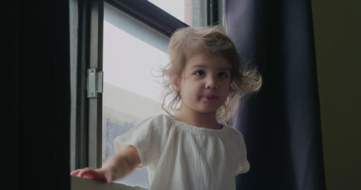 Portrait of a cute, funny little toddler girl at home GIF