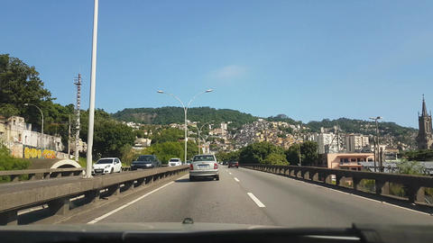 Driving on Road in Rio De Janeiro With Overview of Hillside Favela and Traffic Acción en vivo