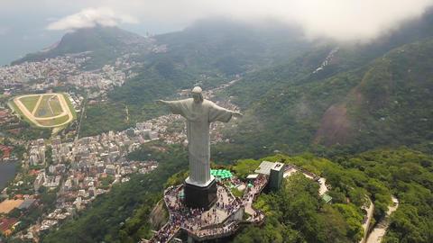 Iconic Jesus Statue Above Rio De Janeiro Brazil Aerial View. Christ The Redeemer Acción en vivo