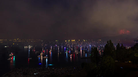 Night view of English Bay in downtown Vancouver of fireworks event Footage