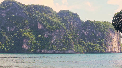 Beautiful Green Cliffy Islands in Azure Tropical Sea Footage