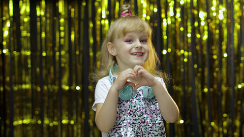Child show heart gesture. Demonstrating amorous feelings, romantic emotions Live Action