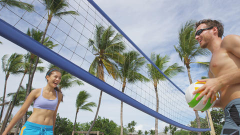 People playing beach volleyball - active lifestyle Live Action