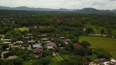Aerial view of green valley with hot spring reacreation center. Scenic green Live Action