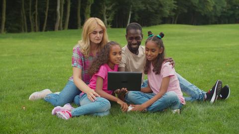 Multiethnic family making video call on tablet pc Acción en vivo