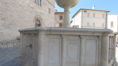 Fountain located in front of the church of San Silvestro of Bevagna Live Action