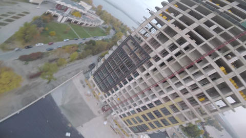 High speed flight, turns and tricks with a freestyle drone, construction site Live Action