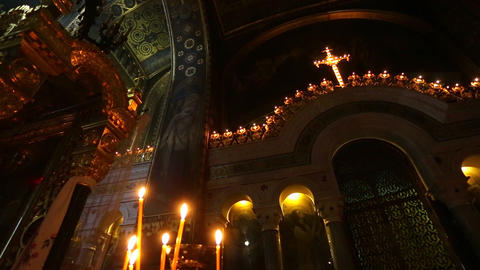 Candles in the interior of the historic orthodox cathedral Live Action