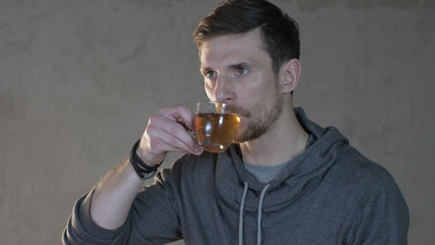 Young Man Drinks Tea From a Glass Footage
