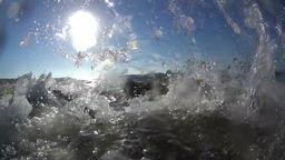 Small waves splashing at the coast, slow motion Footage