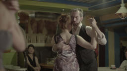Couple dancing in a cafe in the evening Footage