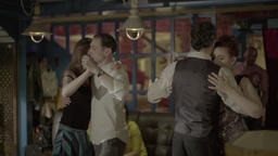 A group of dancers dancing in the evening in the restaurant (cafe) Footage