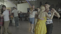 The dancers dance the dance in the hall . Slow motion Footage