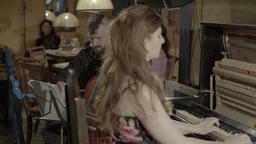 The musicians play the accordion and the piano in the evening Footage