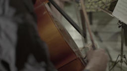 Close-up of hands of a musician who plays the cello Footage
