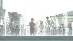 Joyful childhood. Children play in the fountain. Slow motion Footage
