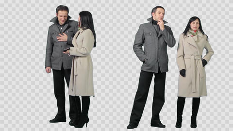 Man & stylish girl are standing side by side in winter clothes Live Action