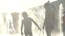 Summer . The girl in the fountain in summer . Slow motion Footage