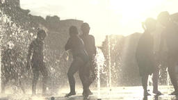 Children in the fountain. Happy childhood . Slow motion Footage