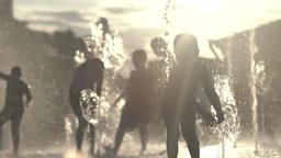 Happy childhood. Children in the fountain at sunset . Slow motion Footage