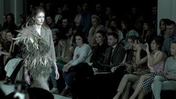 Model shows clothes at the fashion show . Slow motion Footage