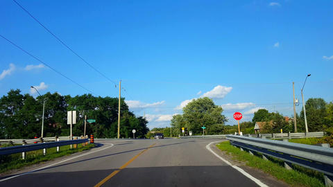 Driving Approaching Rural Stop Sign, Stopping, and Turning Left. Driver Point of View POV Driver Live Action
