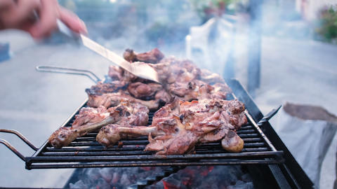 Man hand preparing grilled chiken legs,grilling meat barbecue,outdoors lifestyle Live Action