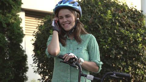 Portrait Of A Cheerful Girl Holding Mobile Phone. Happy smiling student using Live Action