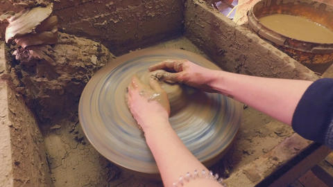 Potter's wheel. Women's hands are trying to make Pot Footage