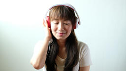 woman with headphones listen to the music Live Action
