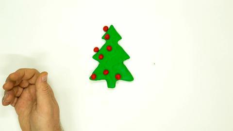 Plasticine animation Christmas tree decoration.4K Live Action