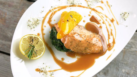 Grilled salmon vegetables and sauce delicious restaurant food top view Live Action